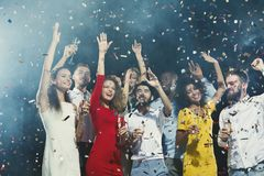 Office new year party. Young people having fun. Office christmas party. Group of joyful colleagues having fun at new year celebration. Happy smiling young people stock photography