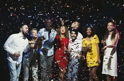 Office new year party. Young people having fun. Office christmas party. Group of joyful colleagues having fun at new year celebration. Happy smiling young people royalty free stock images