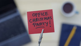 Office christmas party. Written on a memo at the office Stock Images