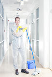 Office cleaning in overalls royalty free stock images