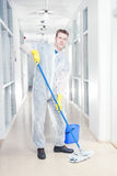 Office cleaning in overalls Stock Image