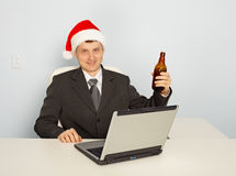 Office clerk celebrate Christmas at work Royalty Free Stock Photos