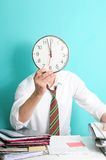 Office clerk with clock Royalty Free Stock Photos