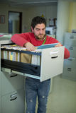 Office clerk looking some files Royalty Free Stock Images