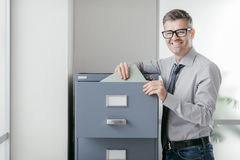 Office clerk searching files Stock Photography