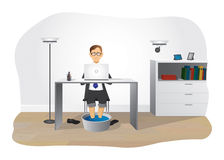 The office clerk. Tired office clerk warms up feet in a bowl of hot water Stock Photos