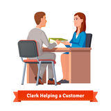 Office clerk working with customer Royalty Free Stock Photo
