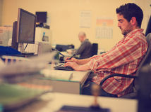 Office clerk writing at pc Stock Photo