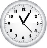 Office clock. Grey office clock  on white Royalty Free Stock Photo
