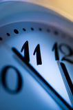 Office clock. Vertical image of blue office clock Stock Photos