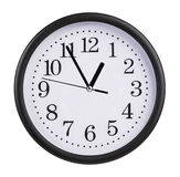 Office clock shows five minutes to an hour Stock Images