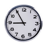 Office clock shows five to nine Royalty Free Stock Photo