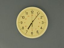Office clock at 7.05 Stock Photo