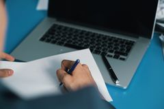 Handle on paper in office Royalty Free Stock Photography