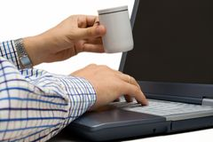 Office coffee break. Taking coffee while working with laptop Stock Images