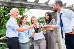 Office colleagues drinking beer after work royalty free stock photos
