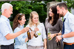 Office colleagues drinking beer after work Stock Photography