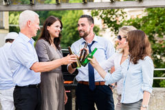 Office colleagues drinking beer after work Royalty Free Stock Images