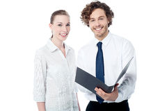 Office colleagues reviewing business file Stock Image