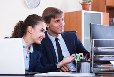 Office colleagues successfully working together Stock Images