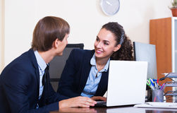 Office colleagues successfully working together Royalty Free Stock Photos