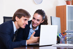 Office colleagues successfully working together Stock Photos
