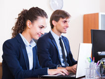 Office colleagues successfully working together Stock Photo