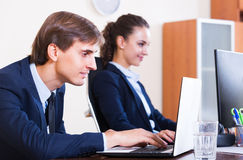 Office colleagues successfully working together Stock Photography