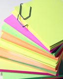 Office colored papers. Colored papers bounded by a clip royalty free stock photo