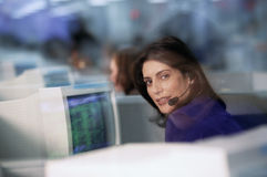 Office communications. People working at computers wearing headsets Stock Photo
