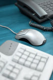 Office - computer mouse, keyboard and phone. Office objects - keyboard, mouse, phone (shallow DOF royalty free stock photography