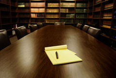 Office Conference Room. Conference room table with several leather chairs and shelves of books royalty free stock photos