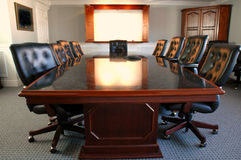 Office Conference Room. Conference room table with several leather chairs stock images