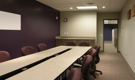 Office conference / workspace with purple wall. Interior of a generic office conference meeting room workspace with purple accent wall, typical generic office royalty free stock images