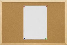Office cork board with blank card Royalty Free Stock Photo