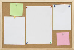 Office cork board with blank card. And pins stock images
