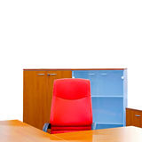 Office corner. Corner of a modern office with red chair royalty free stock photo