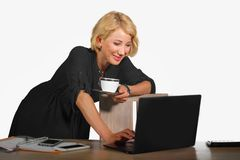 Office corporate portrait of young beautiful and happy business woman working relaxed at laptop computer desk smiling confident in stock photo