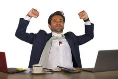 Office corporate portrait of young handsome and attractive happy businessman smiling cheerful and satisfied enjoying business succ stock photography
