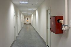 Office corridor. Fire-prevention equipment in office corridor Stock Images