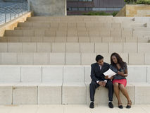 Office couple talk on steps Royalty Free Stock Images