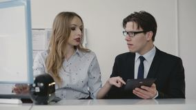 Office coworkers discussing about the issue using pc and tablet. 4K stock footage