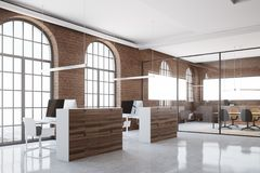Office cubicles in brick office corner. Brick open space office interior with arch windows, a concrete floor and cubicles. A side view. 3d rendering mock up Royalty Free Stock Photos