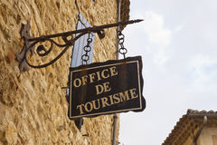 Office de tourisme. Hanged sign in France, Europe Stock Images