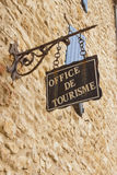 Office de tourisme. Hanged sign in France, Europe Stock Photography