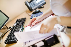 Office desk. Paperwork on a busy office desk royalty free stock images