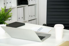 Office desk back view Royalty Free Stock Photos