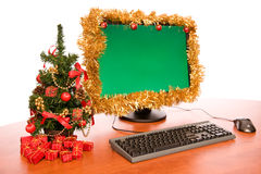 Office desk with beautiful Christmas decoration. On white background royalty free stock photo