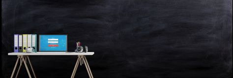 Office desk on a blackboard background. 3d illustration Royalty Free Stock Photography