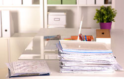 Office desk and a bundle of documents Stock Photo